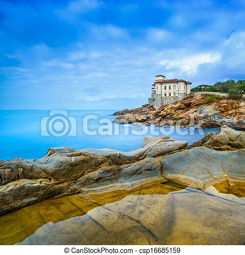 Boccale castle landmark on cliff rock and sea. Tuscany, Italy. Long exposure photography. - csp16685159