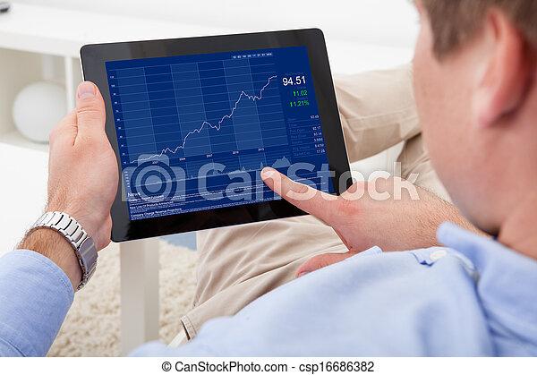 Man Using Digital Tablet - csp16686382