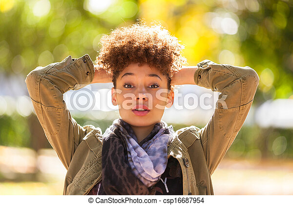 Autumn outdoor portrait of beautiful African American young woman - Black people - csp16687954