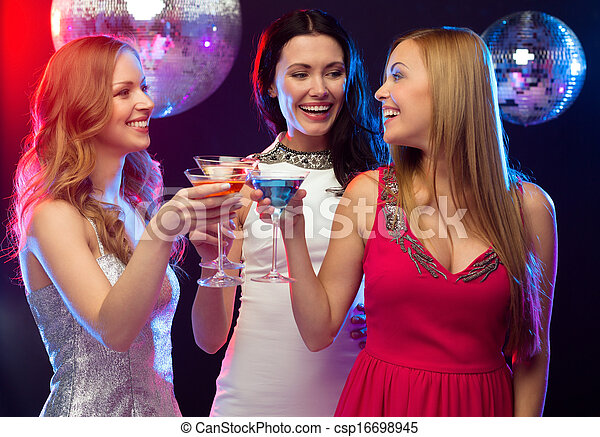 three smiling women with cocktails and disco ball - csp16698945