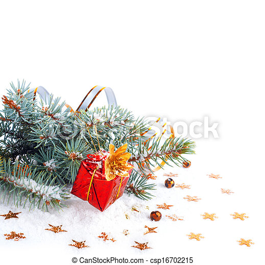Christmas tree branch with a gift in a red box on a white background isolated - csp16702215