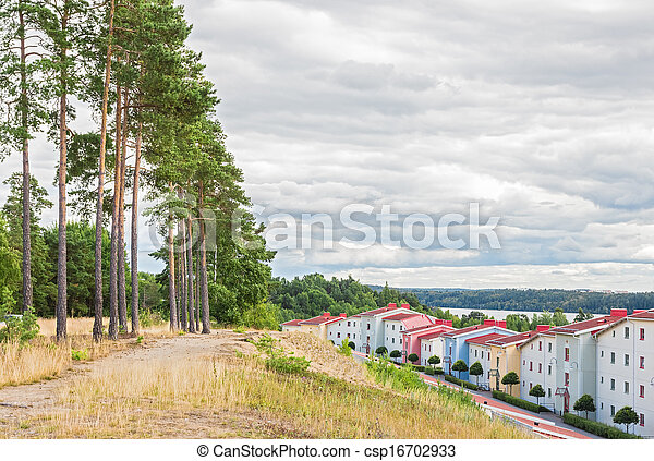 Residential neighborhood surrounded by nature - csp16702933