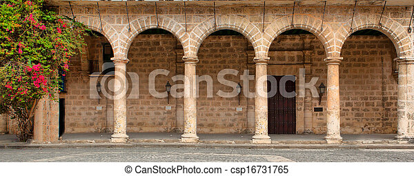 Historic building with arches and flowers - csp16731765