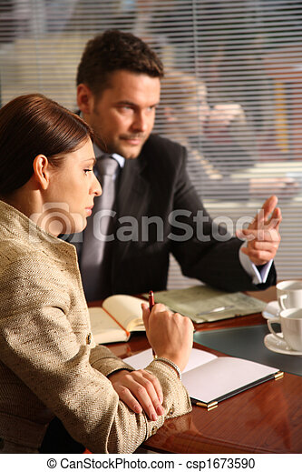 business man and woman talking in the office - csp1673590