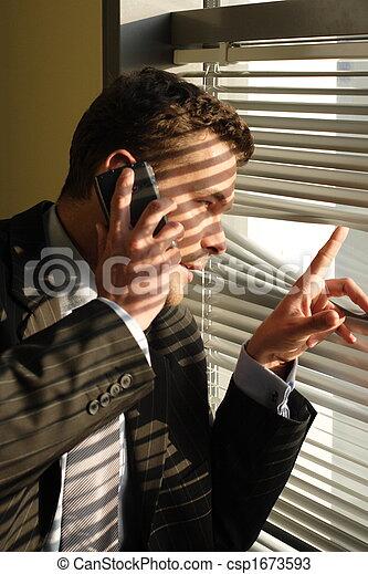 Handsome  calling on phone secret man  - csp1673593