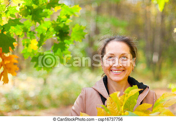 mature woman  in autumn park - csp16737756