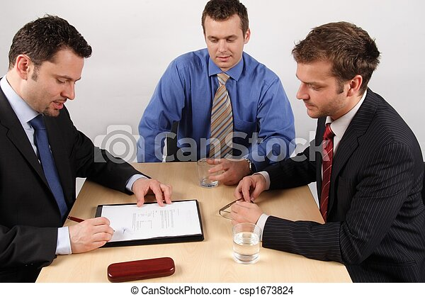 Three businessmen handling negotiations. 1 - csp1673824