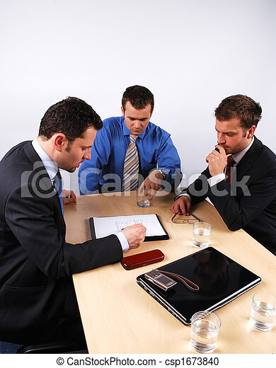 Three businessmen handling negotiations. 1 - csp1673840