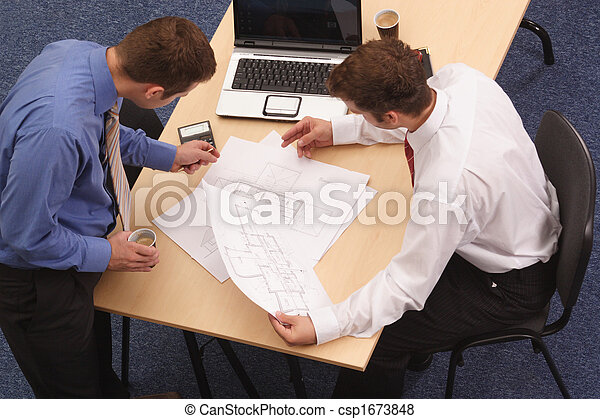 Two architects reviewing the blueprints - csp1673848