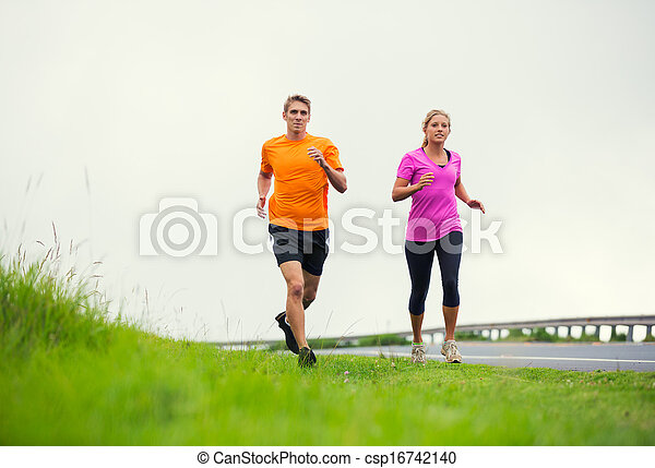 Fitness sport couple running jogging outside - csp16742140