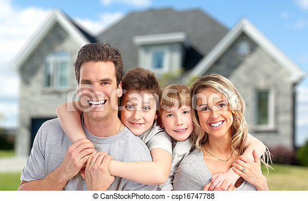 Happy family near new home. - csp16747788