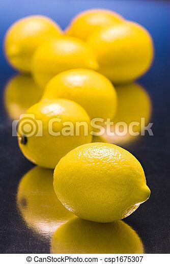 lemons on  blue reflective background - csp1675307