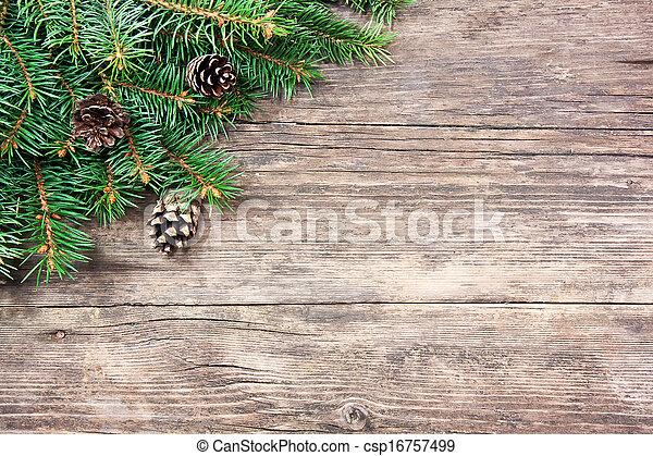 Christmas fir tree on a wooden background - csp16757499