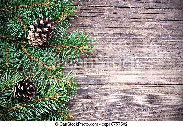 Christmas fir tree on a wooden background - csp16757502