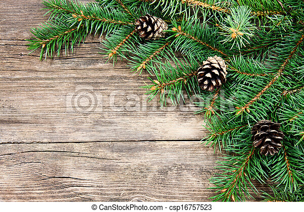 Christmas fir tree on a wooden background - csp16757523