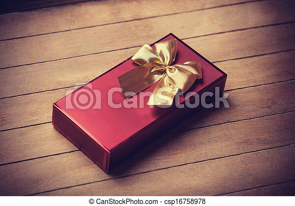 Christmas gift box on wooden table