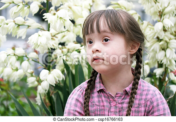 Portrait of beautiful young girl in the park - csp16766163