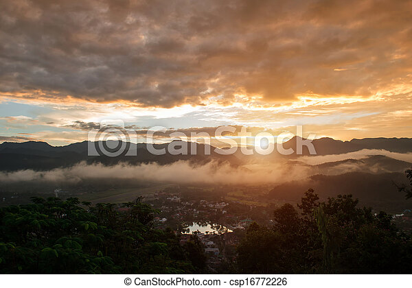 Sunset and mountain and town - csp16772226