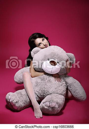 Dreaminess. Sentimental Girl with Soft Toy - Gray Bruin in Embrace - csp16803666