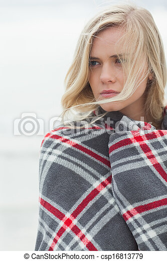 Close up of a young woman covered with blanket - csp16813779