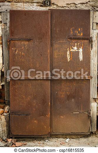 Rusty Metal Door stock photos of old rusty metal door, outdoors shot csp16815535