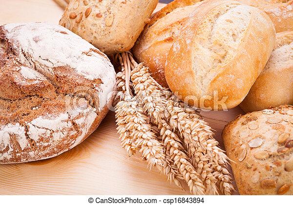 tasty fresh baked bread bun baguette natural food - csp16843894
