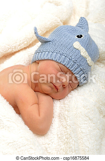 newborn baby in shark hat