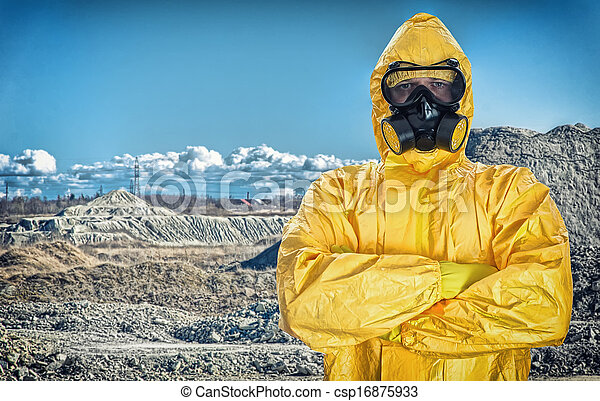 Worker in protective chemical suit over mountains. - csp16875933