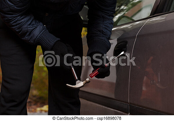 Thief trying to open a car