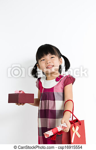 Toddler girl with gift box and bag - csp16915554