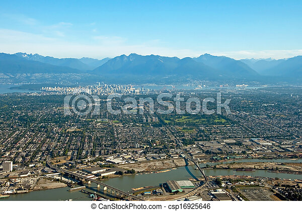 Aerial view of Vancouver downtown city in British Columbia with beautiful mountains in background - csp16925646