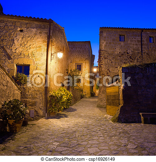 Civita di Bagnoregio landmark, medieval village view on twilight. Italy - csp16926149
