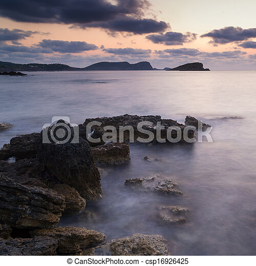 Dawn sunrise landscape over beautiful rocky coastline in Mediterranean Sea - csp16926425