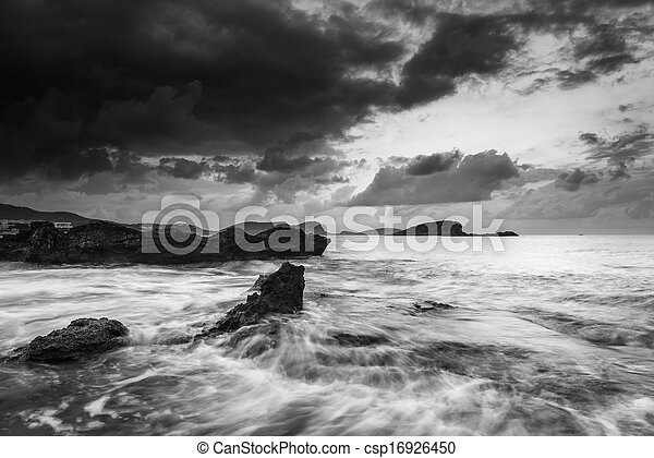 Beautiful sunrise landscape seascape over rocky coastline in Mediterranean Sea in black and white - csp16926450