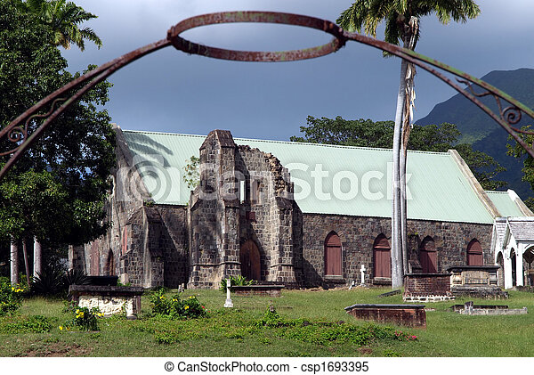 Iron halo over stone church and cemetery in St. Kitts - csp1693395