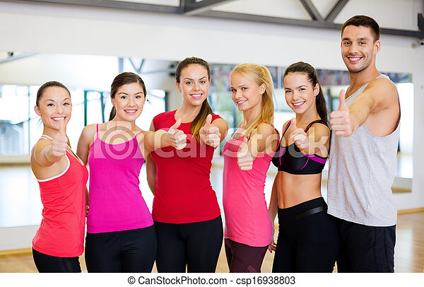 group of people in the gym showing thumbs up
