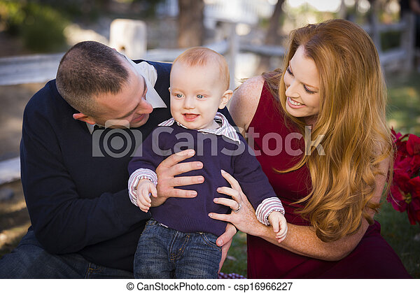 Infant Boy and Young Military Parents Play in the Park - csp16966227