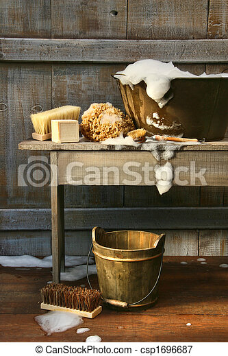 Old wash tub with soap and scrub brushes - csp1696687