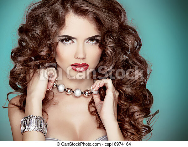Long wavy Hair. Glamour Fashion Woman Beauty Portrait. Beautiful brunette with long curly hairstyle - csp16974164