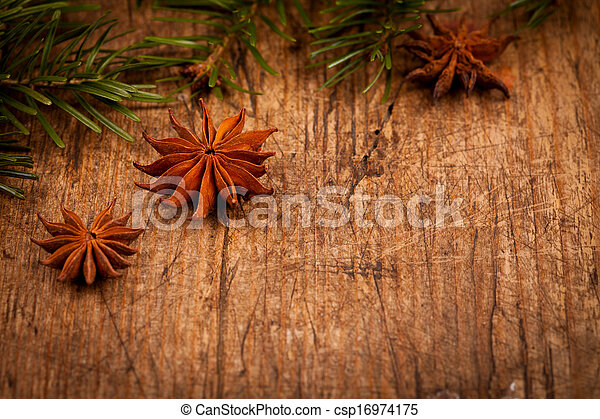 Star anise and branch on wooden background