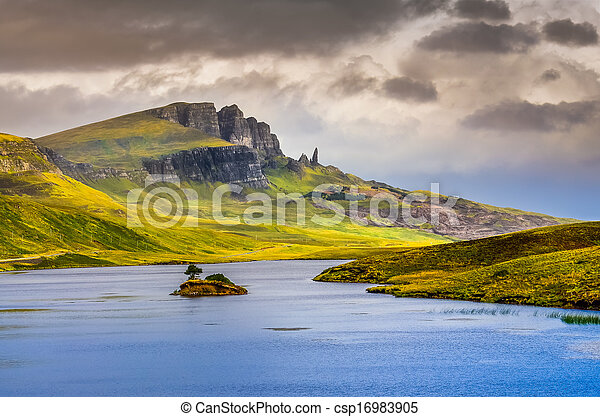 Landscape view of Old Man of Storr rock formation and lake, Scotland, United Kingdom - csp16983905