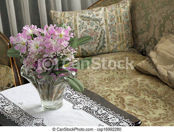 lounge for nobles in a villa with a vase of fresh flowers