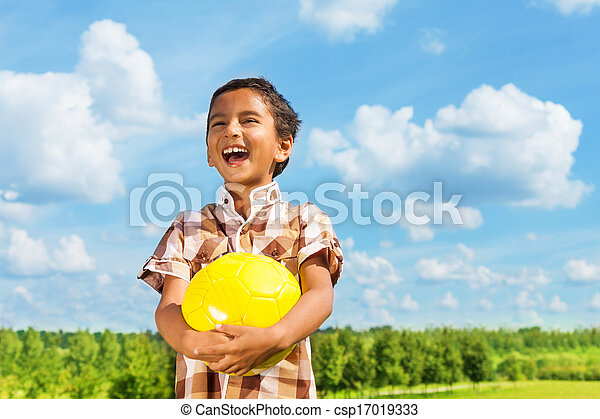 Laughing boy with ball