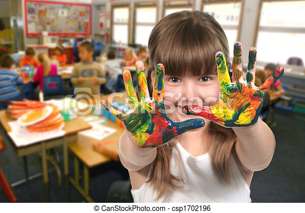 School Age Child Painting With Her Hands in Class - csp1702196