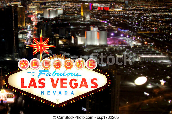 Las Vegas Welcome Sign With Night Time Strip in the Background - csp1702205