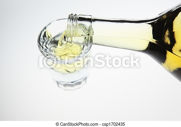 Pouring a shot of tequila - csp1702435