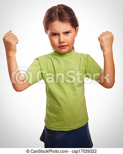 Angry child evil girl shows fists experiencing anger emotions