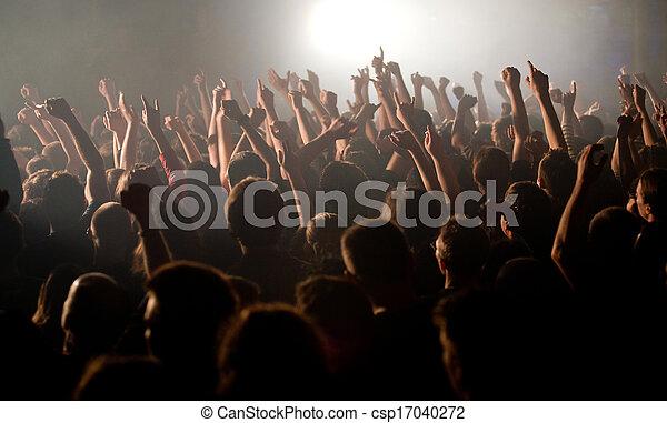 Crowd rises hands