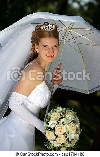 Smiling bride under parasol - csp1704188