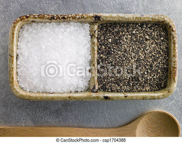 Sea Salt Crystals and Course Cracked Black Pepper - csp1704388
